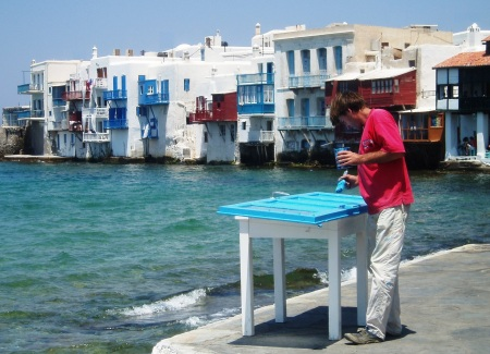 Man Painting Blue Door Mykonos Greece