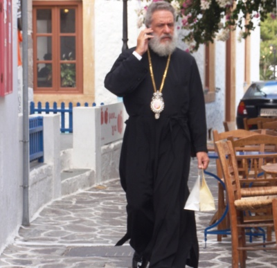 Priest with mobile phone Milos Greece
